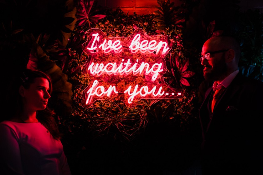nyc couple by lighted sign