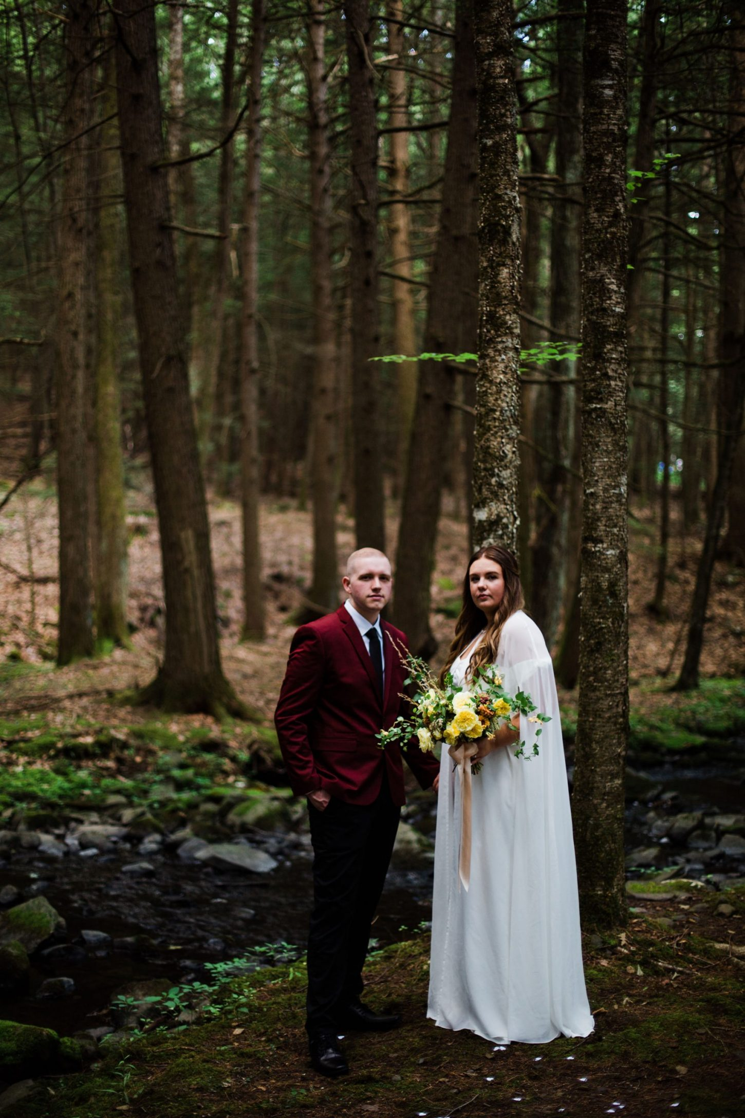 bride and groom in woods at catskills elopement ceremony